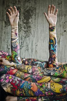 I absolutely love colorful sleeve tattoos.