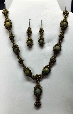 I made this necklace and earrings over the long weekend. I used the Pink Piskota Bracelet pattern that Linda wrote about as the pattern for the main motif. Then I made some connectors and - voila!