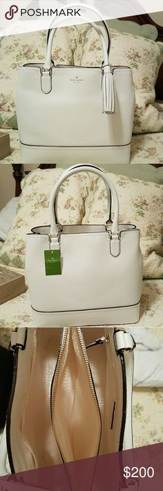 Kate Spade Beautiful white New York McCall Street Jenner handbag. Don't miss this deal it is an amazing bag. 3 compartments, one center zipper, tassel on front, in one compartment you have a large zipped pocket and the other compartment you have 2 large pockets. kate spade Bags