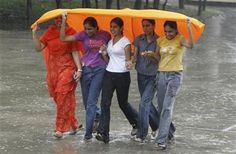 Girls cover themselves from rain in Chandigarh | Free Malaysia Today