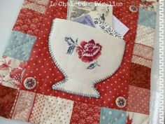 applique a pocket shape or just a shape, you have teapots and cups, then blanket stitch on edges