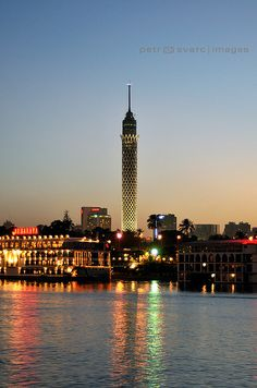 Borg al-Qahira (Cairo or Lotus Tower) Rising above Gezira Island at Dusk, Nile Waterfront, Cairo (Egypt) Egypt Travel, Africa Travel, Places To Travel, Places To See, Places Around The World, Around The Worlds, Cairo Tower, Places In Egypt, Modern Egypt