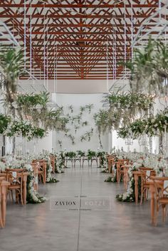 greenery wedding with hanging floral installations, wooden wedding tables with crossback chairs Hanging Orchid, Hanging Flowers, Wedding Centerpieces, Wedding Decorations, Wedding Tables, Wedding Ideas, Green Orchid, Blue Orchids, Event Planning Tips