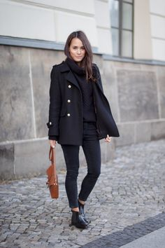All black with skinny Jeans, knitted Sweater and Chealsea Boots