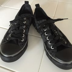 Skull Converse low tops EUC. Rare, Black sneakers with grey skulls(Not Converse) Hot Topic brand. Love these shoes but they are too small for me, so I am rePoshing. They say they are size 8men/10 women but I think they fit more like an 8 1/2 women's . Hot Topic Shoes Sneakers