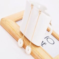 """Faux Pearls on a gold chain make excellant accents to any outfit. 2.5 """" approx."""