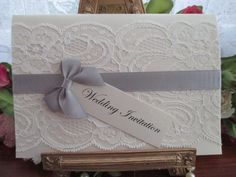 S07432I A6 IVORY LACE WEDDING INVITATION SILVER GREY SATIN RIBBO Available from www.vintagelaceweddingcards.co.uk