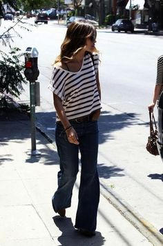 I so love a striped oversized T- made casually, comfortably chic paired with relaxed fit flare-legged jeans,  brown leather belt and loose beachy-wave hair!!  Makes me want to sigh- *sigh*...[Plush Palate]
