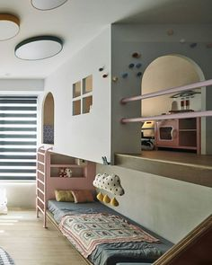 KIDS BEDROOM: @haodesign.tw creates a space that dreams are made of. A secret passage disguised by a little pink door leads to this open and spacious bedroom-wonderland. A customised playground slide, pastel colours and rounded lines inspire its fairy-tale atmosphere. Images course of @haodesign.tw