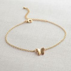 This butterfly bracelet is so dainty and feminine. It is adjustable from 7 - 9 inches, so it will fit any size wrist. The small butterfly charm measures approximately 1/2 inch. Available in gold or silver plated.Please be sure to read the shop policies before making your purchase.