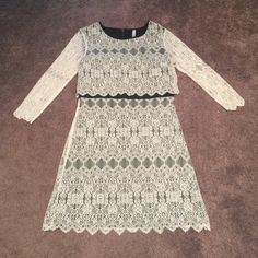 Kensie white and black lace dress. White lace over black lining. Back zipper. Worn once for my bridal shower. Size medium. Fits 4-6. Kensie Dresses