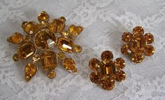 @Ginni Elliott I like this one has matching earrings. Vintage Amber Rhinestone Flower Brooch and Earring Set Pin. $31.95, via Etsy.