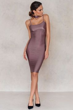 Be the center of attention in this baby! The Basic's Metallic Dress by NaaNaa comes in red purple and features a bodycon fit, spaghetti shoulder straps and a comfy stretch fabric with a metallic shimmer for that extra glow. This dress also comes with a matching wide choker. Put on a pair of killer heels and hit the night.