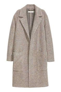 Casaco comprido com lã: Casaco comprido em mistura de lã com corte direito e sem…