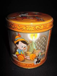 Vintage tin candy/bank container