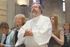 A dozen new deacons in the Atlanta Archdiocese are ordained.