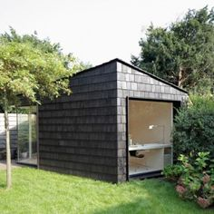 Trapazoid Guest House: Every inch of this tiny backyard studio serves a purpose: as office, sleeping quarters for guests, and bike storage shed. Read on to see how Amsterdam-based architect Serge Schoemaker accomplished it all in 323 square feet: Backyard Guest Houses, Backyard Office, Backyard Studio, Garden Office, Outdoor Office, Shed Office, Cheap Sheds, Shed Design, Studio Design