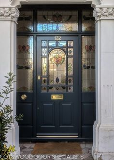 Decorative Edwardian front door painted dark blue with elegant stained glass. Traditional brass door furniture Decorative Edwardian front door painted dark blue with elegant stained glass. Black Front Doors, Wooden Front Doors, Painted Front Doors, Glass Front Door, Glass Doors, Georgian Doors, Victorian Front Doors, Front Door Porch, House Front Door