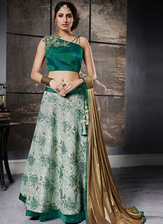 You will be the center of attention in this attire. Keep ahead in fashion with this green jacquard silk lehenga choli. This lovely attire is looking extra beautiful with embelishment of embroidered work. Comes with matching choli and dupatta. (Slight variation in color, fabric & work is possible. Model images are only representative.) Ghagra Choli, Bridal Lehenga Choli, Silk Lehenga, Anarkali, Western Lehenga, Bollywood Lehenga, Sabyasachi, Green Lehenga, Lehenga Choli Online