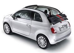 I want this car so badly. Fiat 500 with a roll top.