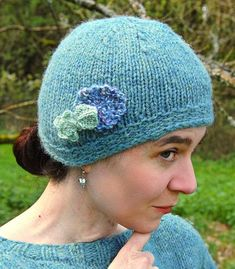 Free Knitting Pattern for The Cat's Pajamas Cloche - This hat is shaped with short rows to be longer at the sides and back so that it covers the ears and base of your neck, but won't fall into your eyes. 3 sizes from child to adult large. Designed by Elizabeth Felgate for Knotions