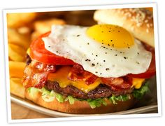 ROYAL RED ROBIN-  Which came first, the bacon or the egg*? Who cares? You can have them both at once! Plus melted American cheese, tomatoes, lettuce and mayo.