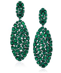 Cellini Jewelers  Oval Rose Cut Emerald Earrings This stunning pair is composed of 37.01 carats of rose cut emeralds. Set in 18-karat blackened gold, and fully articulated.