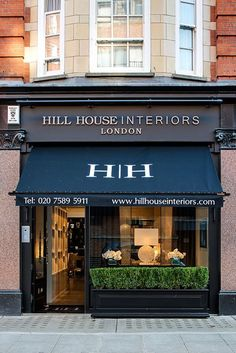 Hill House Interiors. Black storefront awning.  #London  -- love the idea of a long planter across the front to hide less than beautiful storefront in my location.