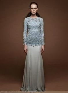 Amelia by Nuritha Harith Raya Luxury 2014 collection.  Looks like the coarseness of something similar to Venetian Lace can be soften with this look. :)
