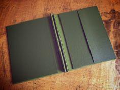 Handmade portfolio lining in dark green buckram, from theendpaper.com