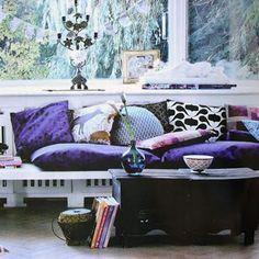 Peaceful boho living space. Fresh vibe with romantic purple tones.