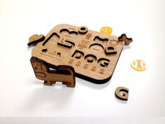 Kid's Puzzle (PUPPY LOVE) by Junichi Tsuneoka - A way to educate young children by physically interacting with the letters and the wooden dog. Children will be able to associate shapes with words that have been laser cut into the wooden block.