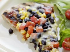 Smoky Corn & Black Bean Pizza  Make it healthy by using a whole wheat pita.  Add tomatoes, fat free cheese, red onions, bell peppers