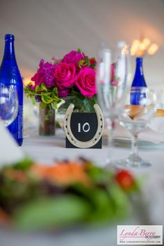 Incorporate your love of horses in your wedding through DIY horseshoe centerpieces. | Lynda Berry Photography