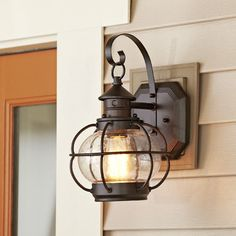 Hastings Outdoor Wall Lantern | The squat, round style of this sconce is reminiscent of vintage lanterns with just a touch of nautical flair.
