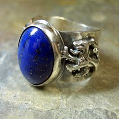 An intense blue lapis guarded by two lions - I want this btw