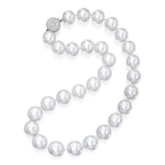 18 Karat White Gold, Cultured Pearl and Diamond Necklace  Composed of 29 cultured pearls measuring approximately 20.1 to 17.0 mm, completed by a pavé-set diamond clasp, length 21 inches.