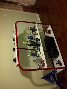 converted an old rusty hockey net (tremclad paint, new netting, installed three shelves) into a trophies display unit. This is a good idea too. Might need to do this to an old net. Especially now that my little guy is playing too. Boys Hockey Room, Hockey Bedroom, Hockey Mom, Ice Hockey, Hockey Stuff, Soccer Room, Basketball Bedroom, Hockey Crafts, Hockey Decor