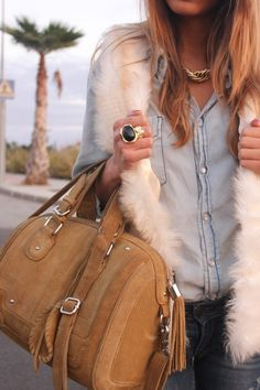 casual friday meet casual hot! i love everything about this from the denim on denim, to the the ring and necklace, that fabulous (hopefully faux) furry vest, right down to the bag. what a great combo of textures. eat your heart out jeans and tshirt crowd, because this outfit will out-fab you any day of the week! yes its all about showing off inspiration!