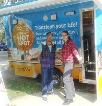 Darren Cottman, Cobbs Creek Branch Manager and Sarah Stippich, Children's Librarian at Cobbs Creek stopped by to say hi and strike a pose in front of the Techmobile! — at Blanche A. Nixon/Cobbs Creek Library.