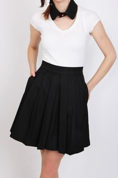 Perfect black pleated skirt, made from fancy black gabardine fabric blend of viscose, polyester and elastane, that has a subtle matte shine to