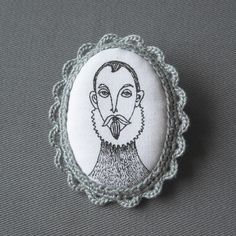 """""""Spanish Gentleman"""" Super cute fabric brooches by Birlbis, in Argentina.  Hand silk-screened and crocheted. Etsy."""