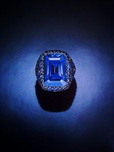 JAR Paris. SPECTACULAR SAPPHIRE RING. Set with a rectangular-cut sapphire of 44.23cts., within a pavé-set sculpted silver mount completely embellished with circular-cut sapphires and amethysts. Mounted by JAR, Paris.  Price Realized $165,000 / Estimate $150,000 - $200,000. - Every so often a designer emerges whose work defies much of what has come before him. Such a designer is Joel Arthur Rosenthal, better known by his trade name, JAR. Drawing upon the past but allowing his natural…