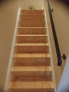 After we took off the carpet and zillions of staples here it is new sanded stairs.