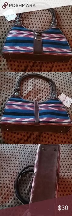 J. Morello Antigua Guatemalan Handbag This beautiful handbag has dark brown suede leather trimming, which include, handles, bottom, inner flap and all around edges. Two front snap closures, one on the inside with interior flap, the other on the outside which is a  short strap and snap closure. Outside of the purse has the gorgeous stripe typical cloth pattern material which traditionally is used in many  Guatemalan clothing and other goods, very beautiful. Made in Guatemala, by artist…