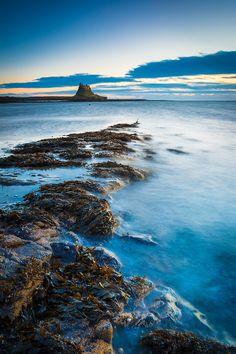 NE, England, Northumberland, Holy Island, Winter Sunrise. A cold and very windy…