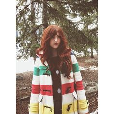 Luv the stripes and colors on this coat.. and her hair:)