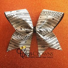 A personal favorite from my Etsy shop https://www.etsy.com/listing/263553481/cute-aztec-arrow-cheer-bow