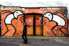 London-based artist Stik in front of his creation 'Angry Stik'; Image by Tara Murray, courtesy Street Art NYC Hipsters, Urbane Kunst, Virgin Atlantic, Amazing Street Art, London Street, Walking Tour, Urban Art, Graffiti, Scene