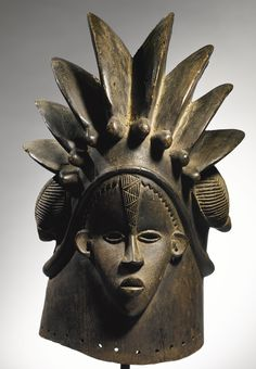 Africa | 'Bandu' janus helmet mask from the Bassa people of Liberia | Wood. H: 43,2 cm | Acquired by Charles D. Miller, III from a Bassa paramount chieftainesse named Esther Jawara, in compound seven, eastern coastal Liberia, 1970s